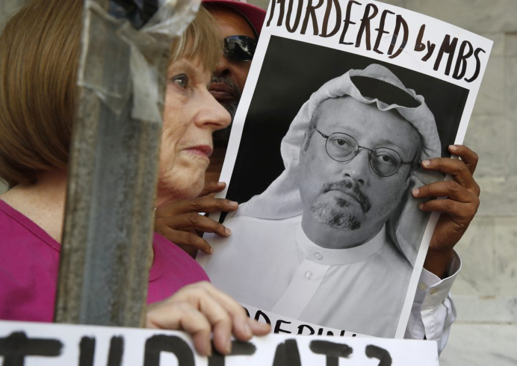 Protesters demonstrate outside the Saudi Embassy in Washington on Wednesday. The U.S. is demanding answers to the suspected assassination of Saudi journalist Jamal Khashoggi, pictured, President Trump says.
