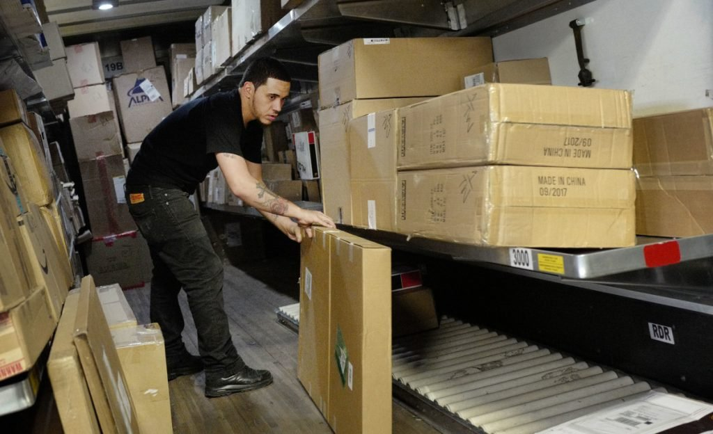 A UPS employee preps a truck at a facility in New York. Heading into the holiday season, the job market is the tightest it has been in nearly five decades. UPS plans to hold nearly 170 job fairs around the country on Oct. 19, hoping to fill out its ranks.