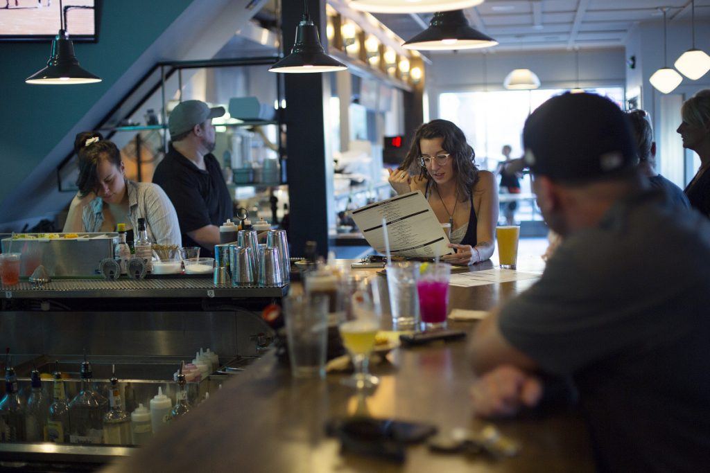 Danielle Gismondi of Portland looks over the menu at the bar at Elsmere's new Portland location.