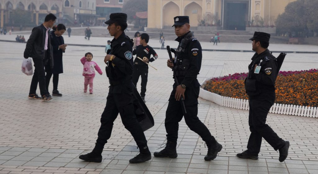 Security personnel patrol in western China's Xinjiang region last year as the national government pushes a policy that targets Muslim minorities.