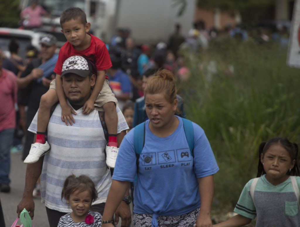 Some 2,000 Hondurans move toward the border with Guatemala to flee poverty and violence and seek new lives in the United States, in Ocotepeque, Honduras, on Monday.