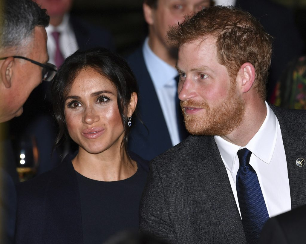 Prince Harry and his wife, Meghan, Duchess of Sussex, meet guests at a reception inside Sydney's iconic Opera House on Saturday.