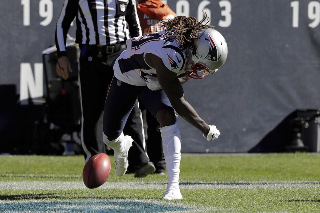 New England's Cordarrelle Patterson spikes the ball to celebrate after return a kickoff 95 yards for a touchdown against the Bears on Sunday in Chicago.
