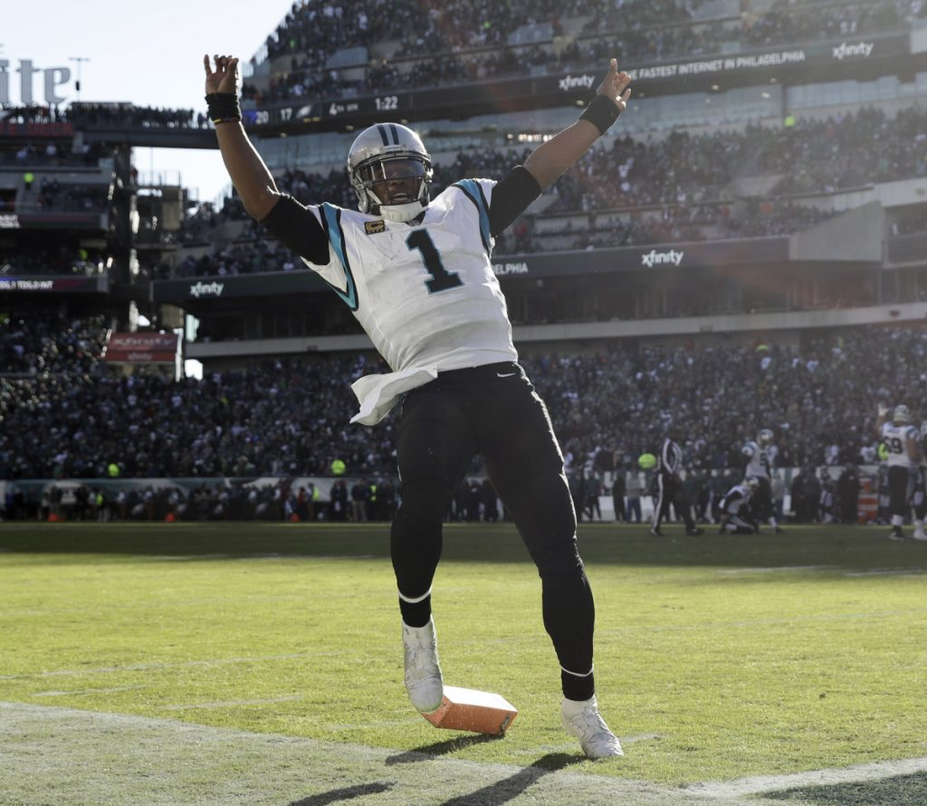 Cam Newton celebrates after his touchdown pass to Greg Olsen capped Carolina's fourth-quarter rally for a 21-17 win over the Eagles.