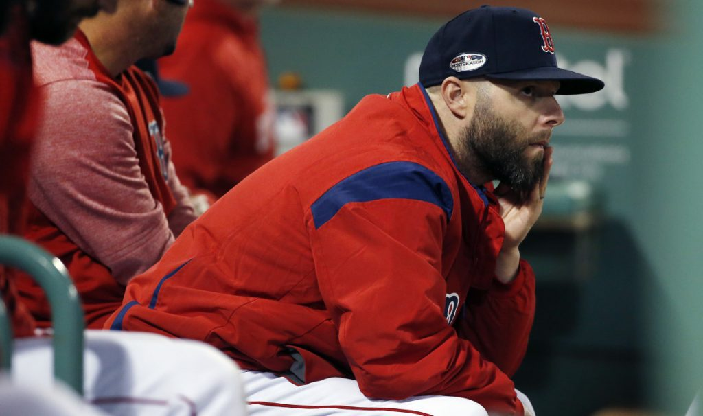 Boston's Dustin Pedroia watches from the dugout in the late innings of Game 2 of the AL Division Series against the Yankees on Oct. 6. Pedroia only played in three games this season, but teammates respect his veteran leadership.