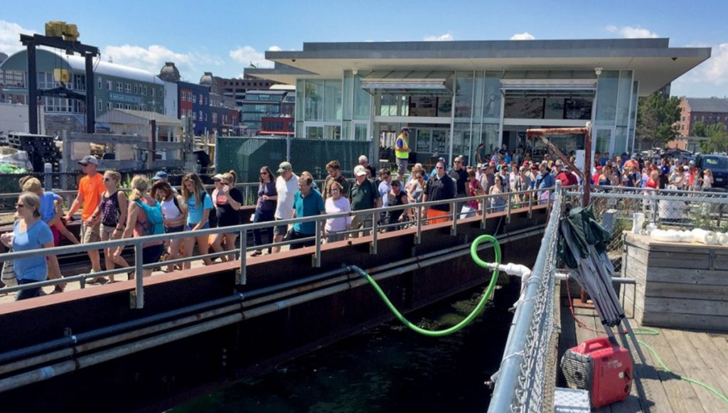 Lines form for a Casco Bay Lines ferry in July. During one three-hour period over the Fourth of July this summer, nearly 2,000 people rode ferries to Peaks Island alone.