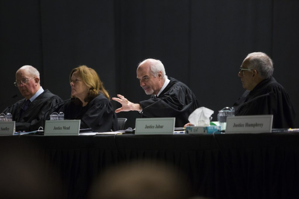 Justices of the Maine Supreme Judicial Court hear oral arguments in the landlord's appeal Thursday at Wells High School as part of the court's annual session before students.