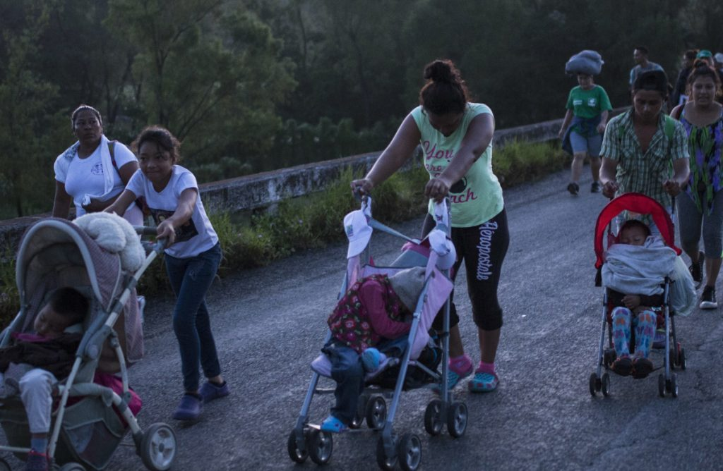 Starting out before dawn, Central American migrants make their way to Pijijiapan, Mexico, on Thursday.