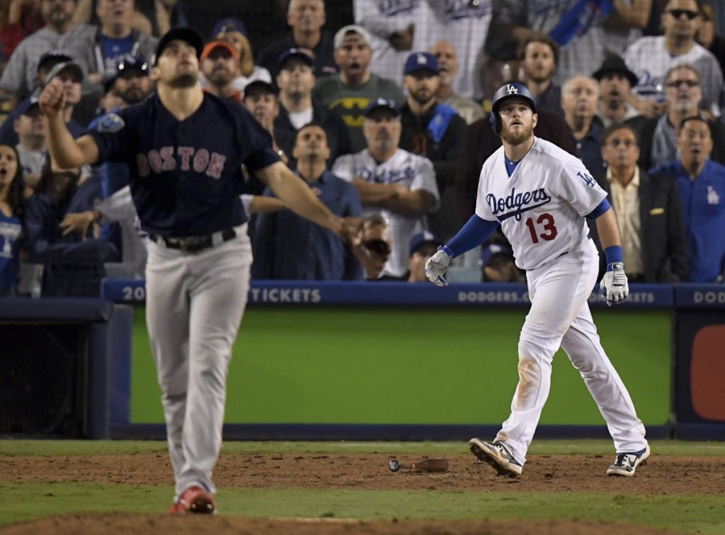 Los Angeles's Max Muncy watches his walk off home run off Boston pitcher Nathan Eovaldi during the 18th inning in Game 3 of the World Series on Saturday morning in Los Angeles.