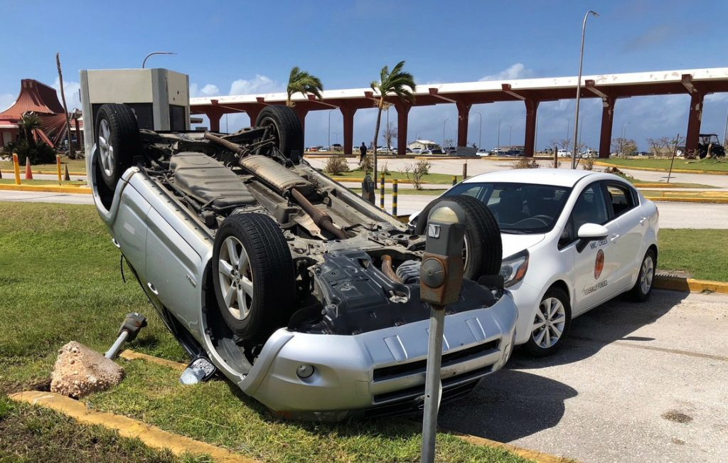 An overturned car is shown at the airport after Super Typhoon Yutu hit the U.S. Commonwealth of the Northern Mariana Islands in Garapan, Saipan.