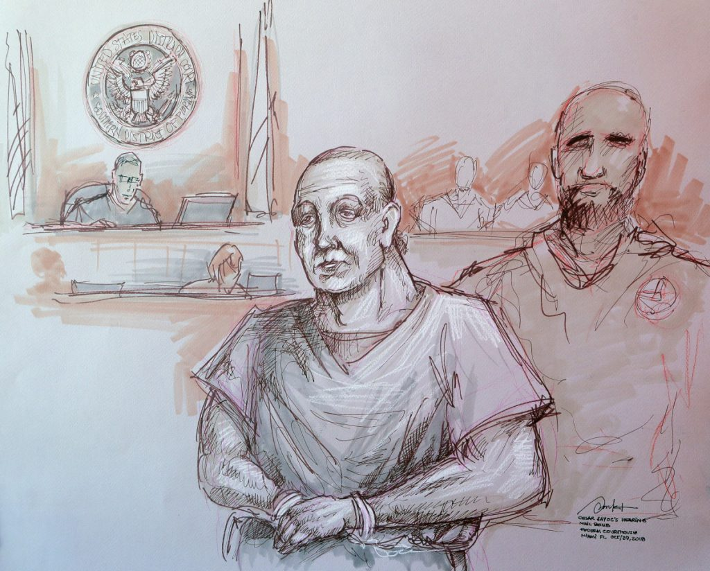 In this courtroom sketch, Cesar Sayoc, left, appears in federal court on Monday in Miami. Sayoc is accused of sending pipe bombs to prominent Democrats around the country. A judge will hold a hearing Friday on whether Sayoc can be released on bail.