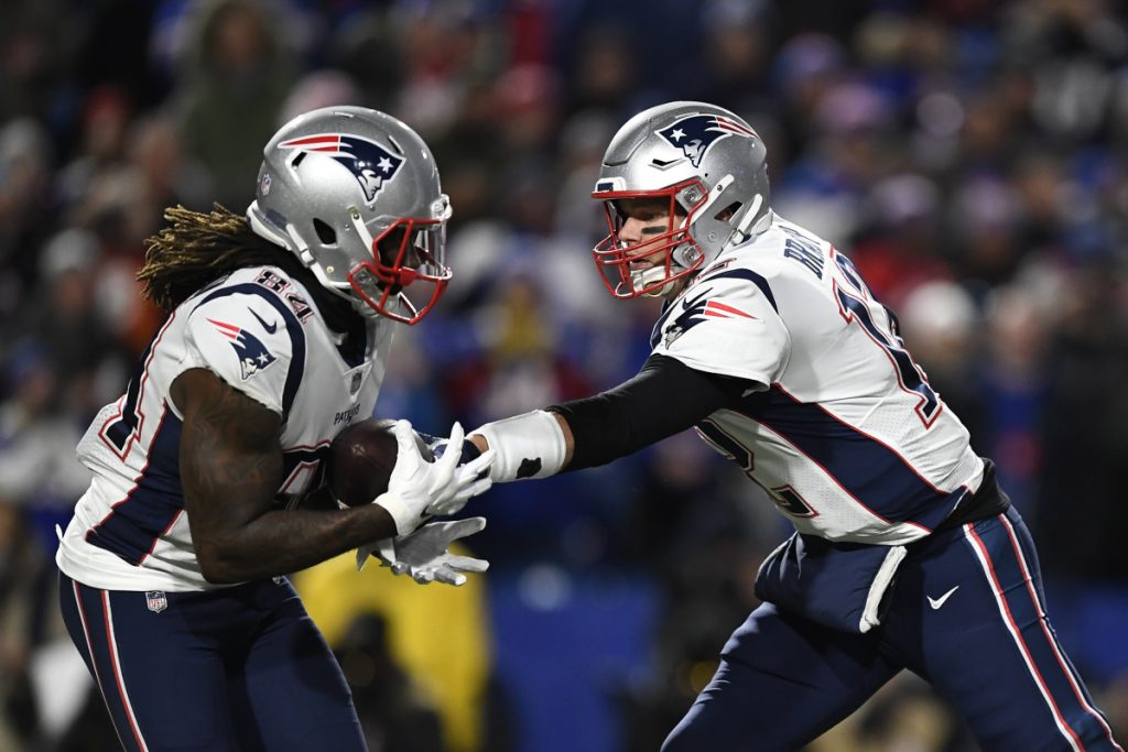 Patriots quarterback Tom Brady hands off to wide receiver Cordarrelle Patterson, who played at times in the backfield and rushed 10 times for 38 times against the Buffalo Bills.