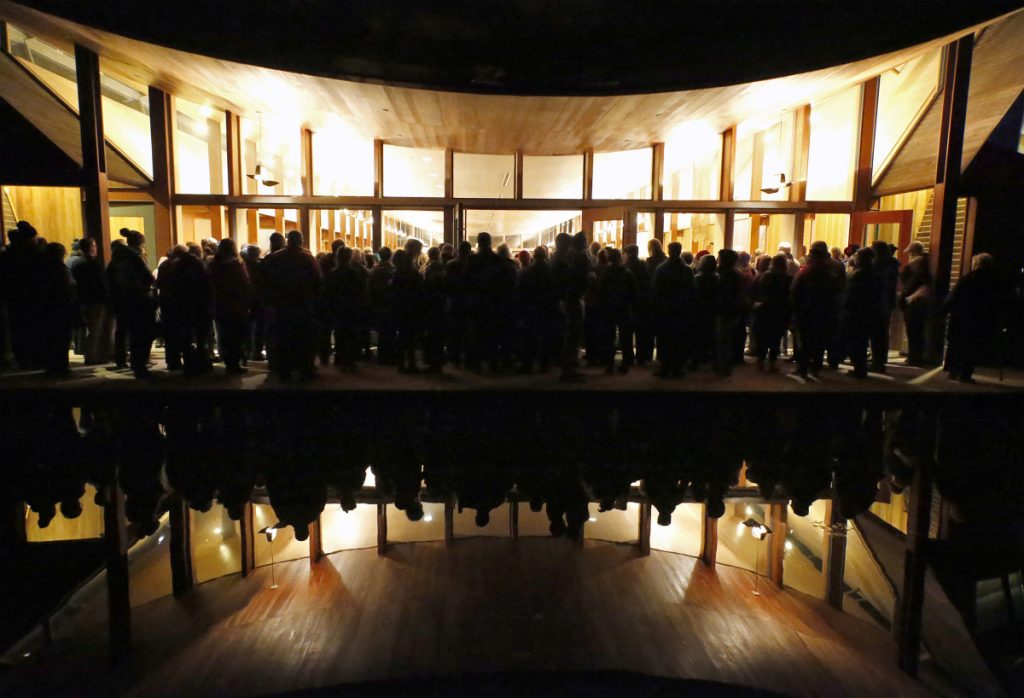 "People who couldn't get into the synagogue listen to the speakers from an outdoor patio area near a reflecting pool. Molly Curren Rowles of the Jewish Community Alliance called the response to the vigil ""remarkable."""