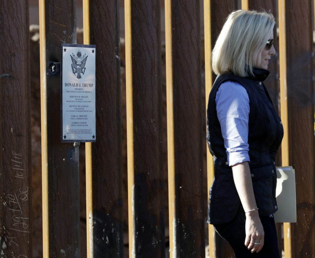 U.S. Department of Homeland Security Secretary Kirstjen Nielsen inspects a newly fortified border wall structure Friday in Calexico, Calif. Associated Press/Gregory Bull