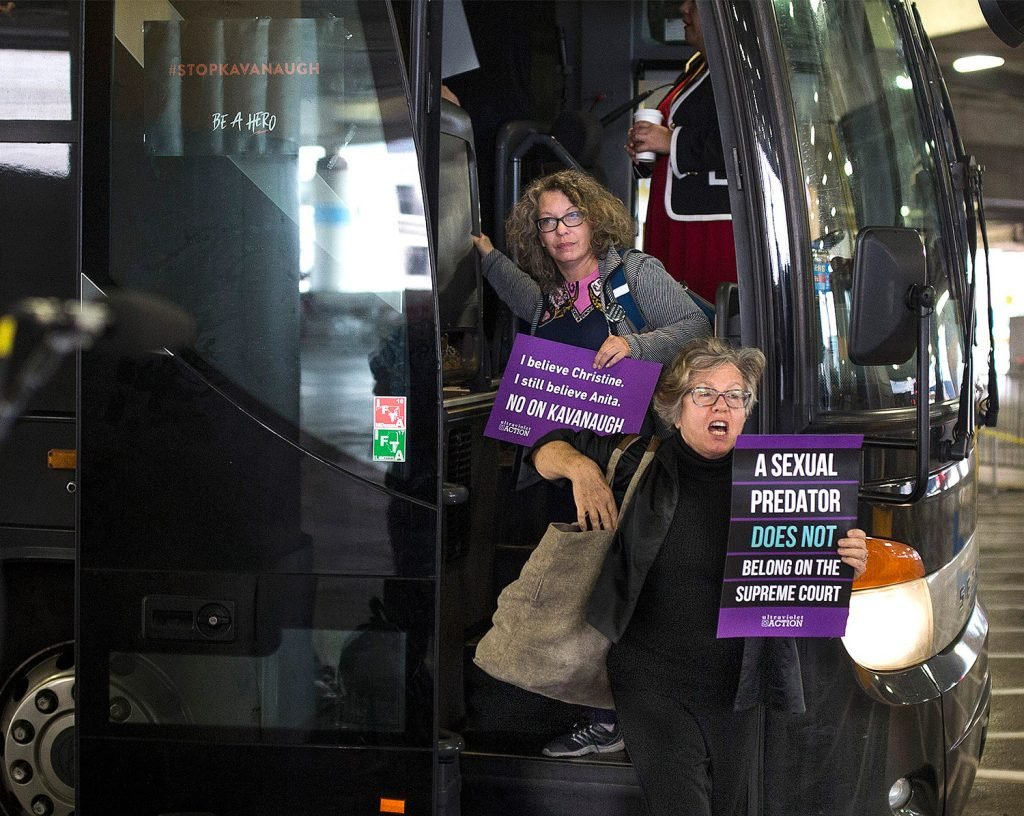 "Susan Feiner, front, gets off a bus at Union Station in Washington, D.C., with a group of Mainers on Oct. 4. The group traveled from Maine overnight in hopes of meeting with Sen. Susan Collins to voice their opposition to then-Supreme Court nominee Brett Kavanaugh. Feiner, a retired USM professor, has been barred from teaching because she offered students a ""pop-up"" course for credit to take the bus to D.C. with demonstrators."
