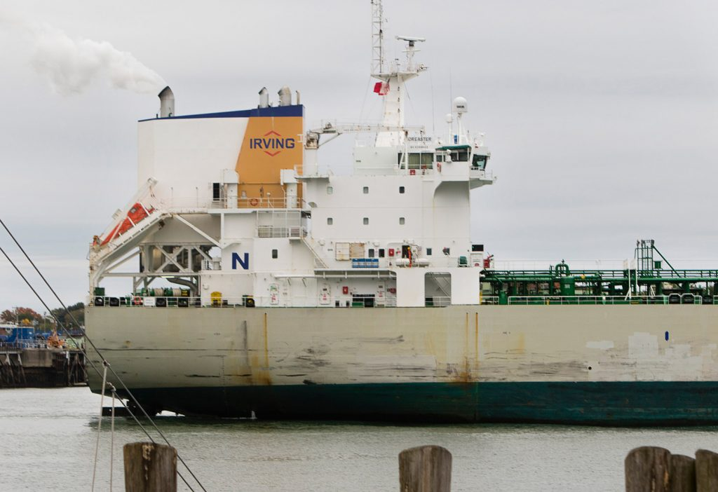 An Irving oil tanker sails through Portland Harbor on Monday.