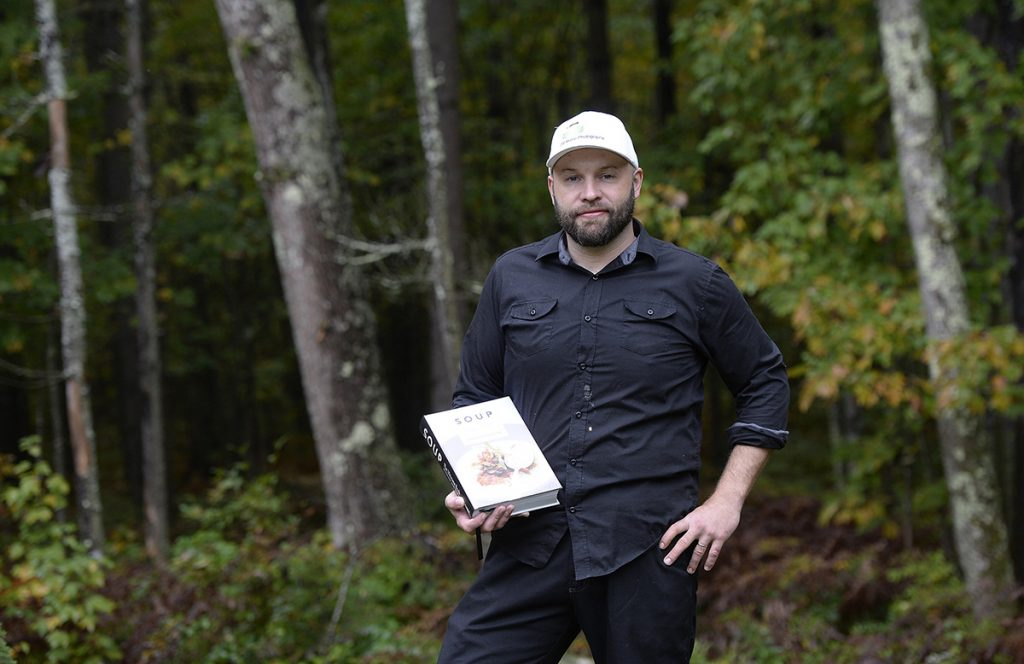Derek Bissonnette of DB Maine photography holds his book Soup Tuesday, October 2, 2018.