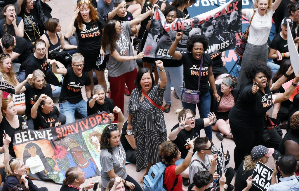 Protesters opposed to Supreme Court nominee Brett Kavanaugh take over the atrium of the Hart Senate Office Building in Washington, D.C., on Thursday, after senators received the new FBI report on sexual-assault allegations against him.