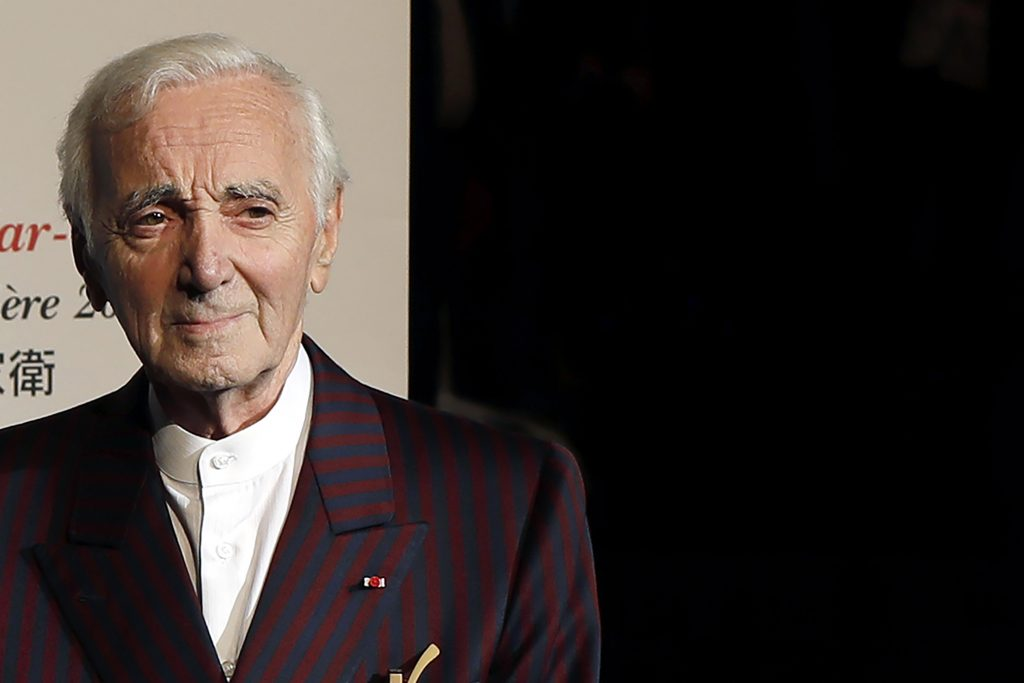 French singer Charles Aznavour poses for photographers on Oct.20, 2017, as he arrives to attend the 9th Lumiere festival Award ceremony, in Lyon, central France. Aznavour, whose performing career spanned eight decades, has died. He was 94.