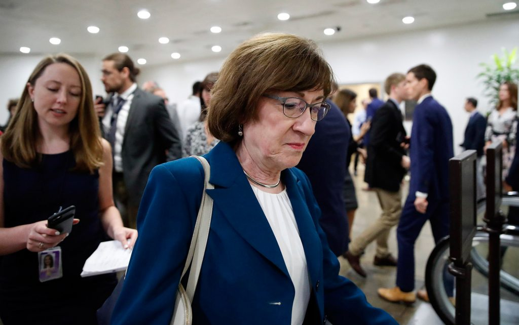 Sen. Susan Collins, R-Maine, walks on Capitol Hill on Wednesday in Washington. The corridors outside her office were cleared by Capitol Police and media were being kept away, apparently because of security concerns, according to a CNN reporter.