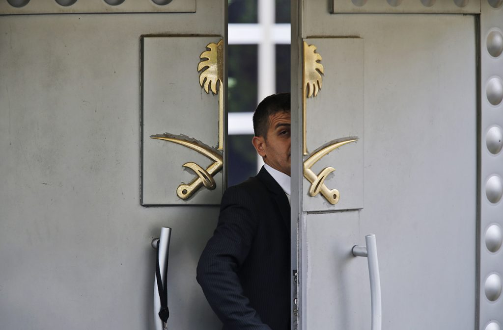 A security guard walks in the Saudi Arabia consulate in Istanbul, Turkey, on Tuesday. The Trump administration's ongoing courtship of Saudi Arabia is on pause over allegations that the key U.S. ally is involved in the mysterious disappearance of a Saudi writer and dissident who went into his nation's consulate in Turkey but never came out.