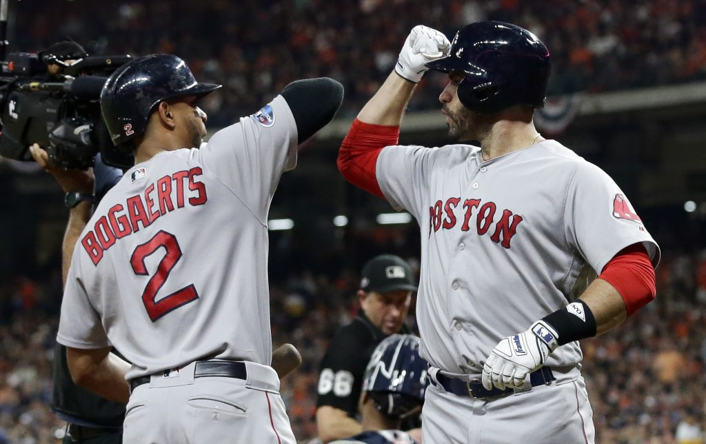 J.D. Martinez, right, and Xander Bogaerts are part of a high-powered Boston Red Sox offense, which leads the team into the World Series against the Los Angeles Dodgers.