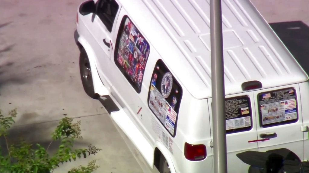 A van parked in Plantation, Fla., on Friday that federal agents and police officers examined and took away on a flatbed truck.