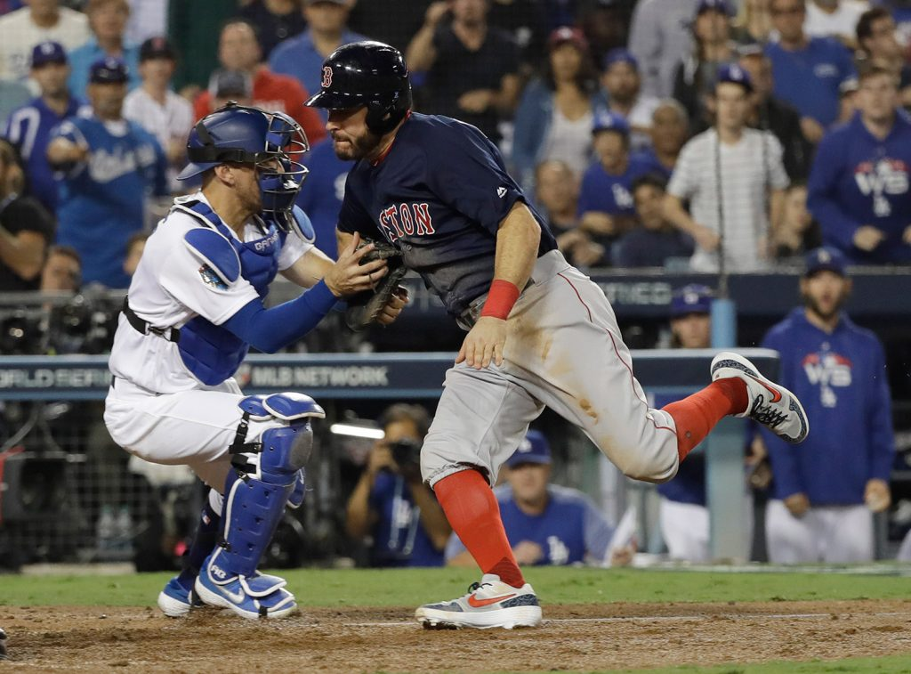 Ian Kinsler is tagged out at the plate by Dodgers catcher Austin Barnes while trying to score the go-ahead run on a fly ball by Eduardo Nunez in the 10th inning.