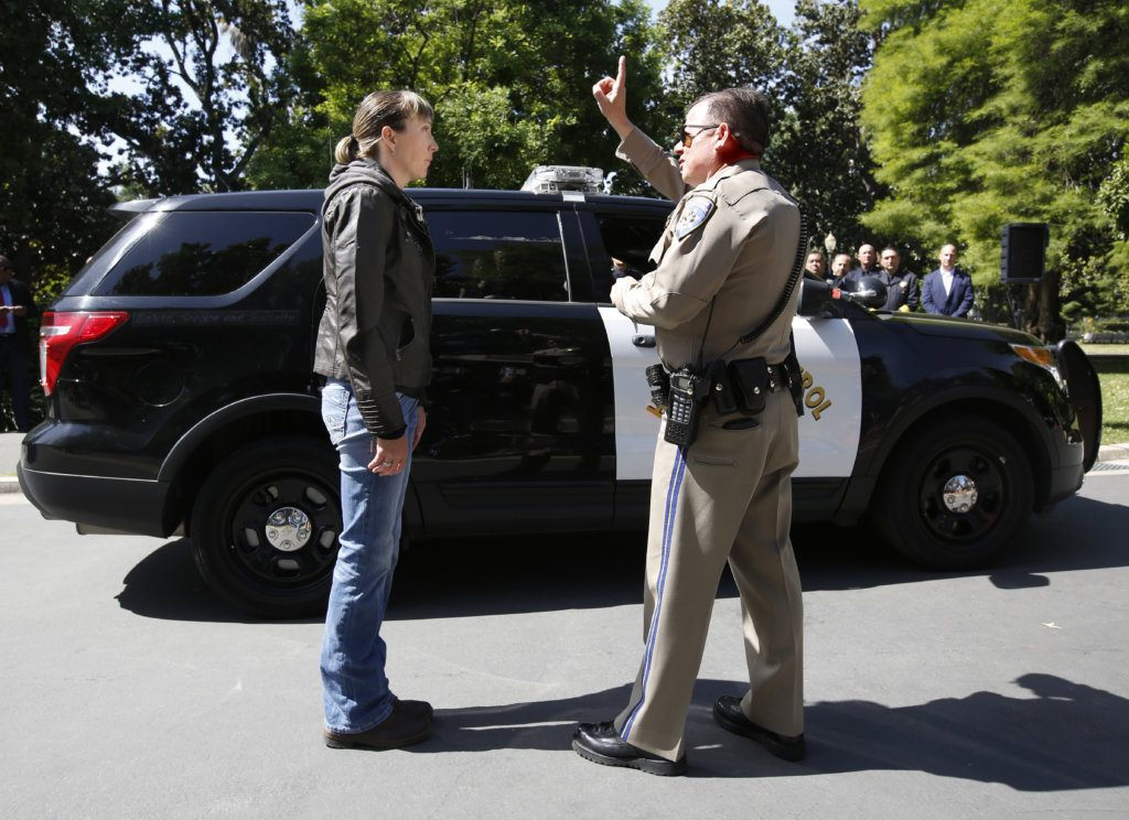 California Highway Patrol Officer Gary Martens, right, has CHP Sgt. Jaimi Kenyon, follow his finger during a demonstration of how drivers, suspected of impaired driving, are currently tested, Wednesday, May 10, 2017, in Sacramento, Calif. Three of California's largest counties are testing a device that can detect the presence of drugs in saliva within five minutes. Some officers and lawmakers want the devices used statewide after voters passed Proposition 64 in November, legalizing the recreational use of marijuana.