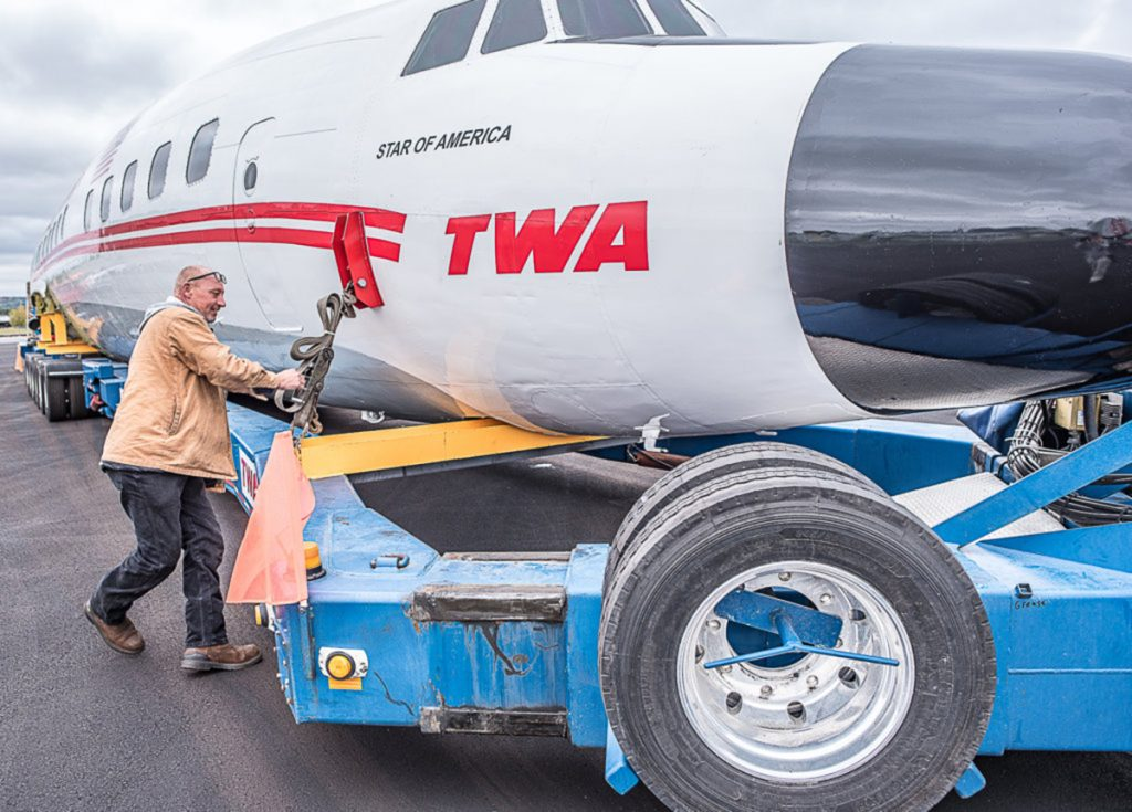 Marty Batura, from Worldwide Aircraft Recovery, checks the rigging on the body of the TWA aircraft, which is being moved to JFK airport to join the TWA Hotel complex as a cocktail bar.
