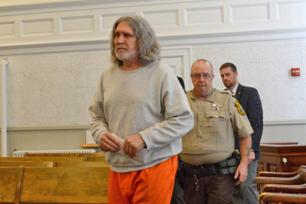 "James ""Ted"" Sweeney, 58, formerly of Jay, enters Franklin County Superior Court on Thursday in Farmington, followed by jail transport officer Cpl. Phillip Richards and court officer Cpl. John Irving. Sweeney pleaded not criminally responsible by reason of insanity in the bludgeoning death of his girlfriend in Jay last year."