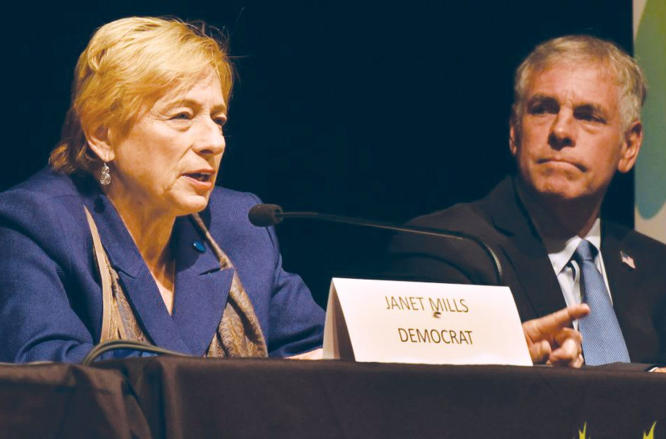 Democrat Janet Mills and Republican Shawn Moody, shown at a debate in Waterville on Oct. 4, aren't putting much stock in a new poll showing Mills with an 8-point lead in the race for governor.