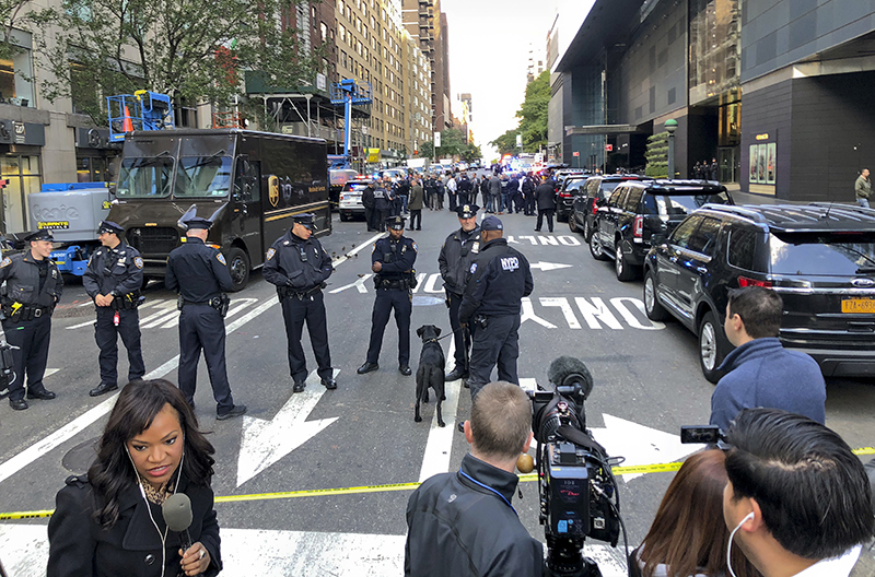 New York Police stand outside the Time Warner Center at Columbus Circle on Wednesday in New York City. A police bomb squad was sent to CNN's offices at the center, and the newsroom was evacuated because of a suspicious package.