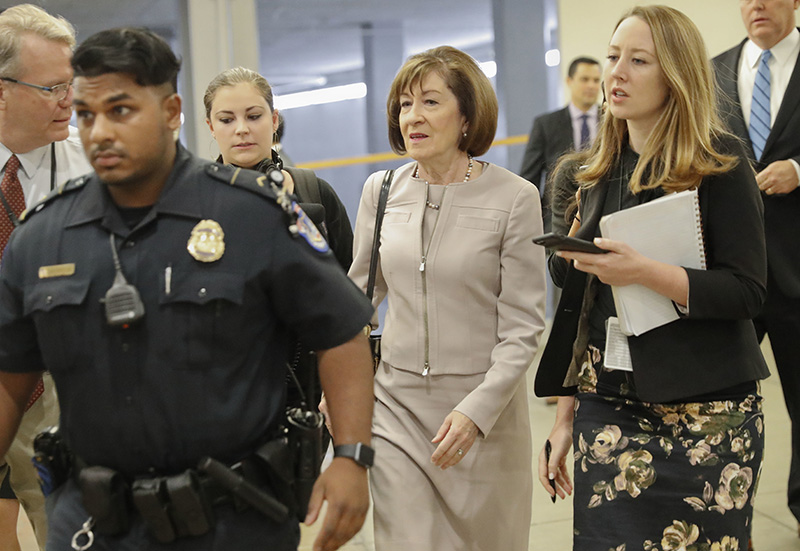 Sen. Susan Collins, R-Maine, is followed by members of the media as she walks to the Capitol before a vote to advance Brett Kavanaugh's nomination to the Supreme Court, on Capitol Hill, Friday, Oct. 5, 2018 in Washington.