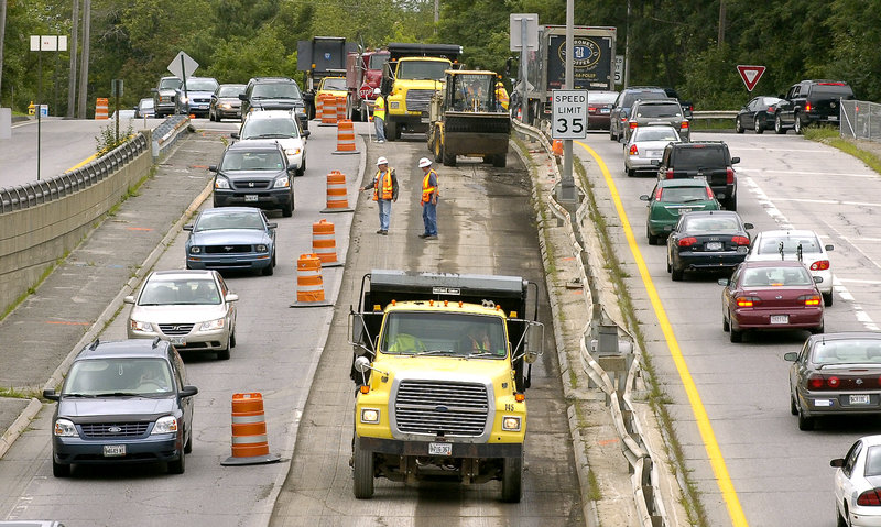 Route 1 in Brunswick undergoes repaving in a 2008 file photo. The American Society of Civil Engineers gave Maine a D for roads in a recent update on the state's infrastructure.