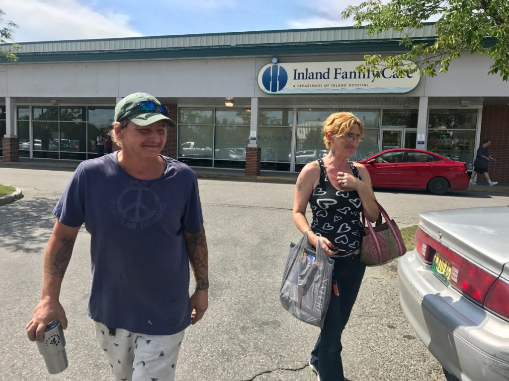 Melvin Hubbard, left, and Bobbie-Sue Glidden, right, leave Dollar Tree in Waterville on Aug. 15, carrying a plastic shopping bag. The pair said they would be against a proposed ordinance to ban plastic shopping bags at retailers over 10,000 square feet.