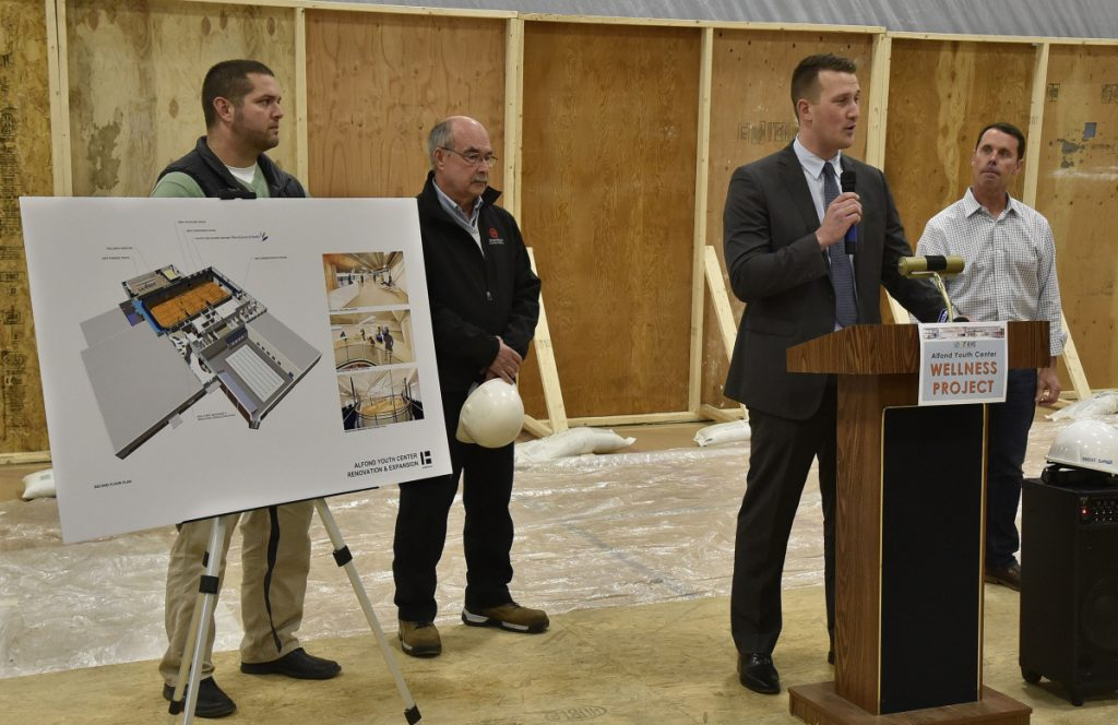 From left, Steve McCarron and Mitch Sammons, of Fairfield-based Sheridan Construction; John Ellis, of Harriman in Portland, and project manager Brent Burger describe the $6.12 million Alfond Youth Center Wellness project and its expected progress at a groundbreaking ceremony Thursday in Waterville.