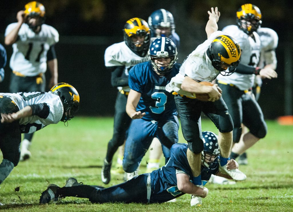 Maranacook quarterback Chris Reid can't escape Dirigo's Dallas Berry as he drags him down before he can get into the secondary during the first half of Friday night's Class E playoff game in Dixfield.