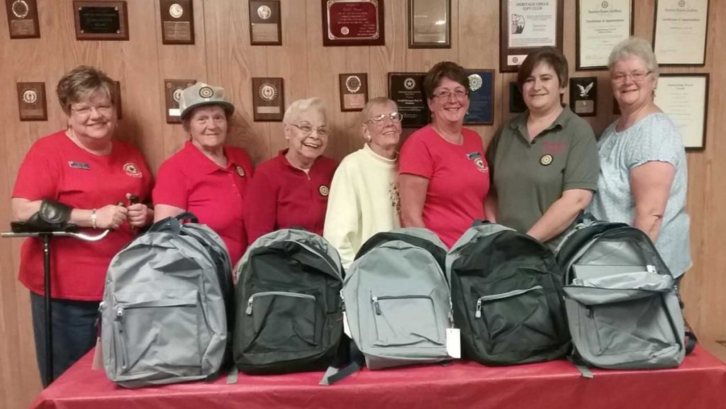 Madison American Legion Auxiliary, Unit 39, members filled school backpacks with school supplies to be distributed to four local schools in the Madison and Anson area this year. From left are Robin Turek, Shirley Emery, Betty Dow, Ann Cody, Harriet Bryant, Tena Ireland and Sharon Ziacoma, .