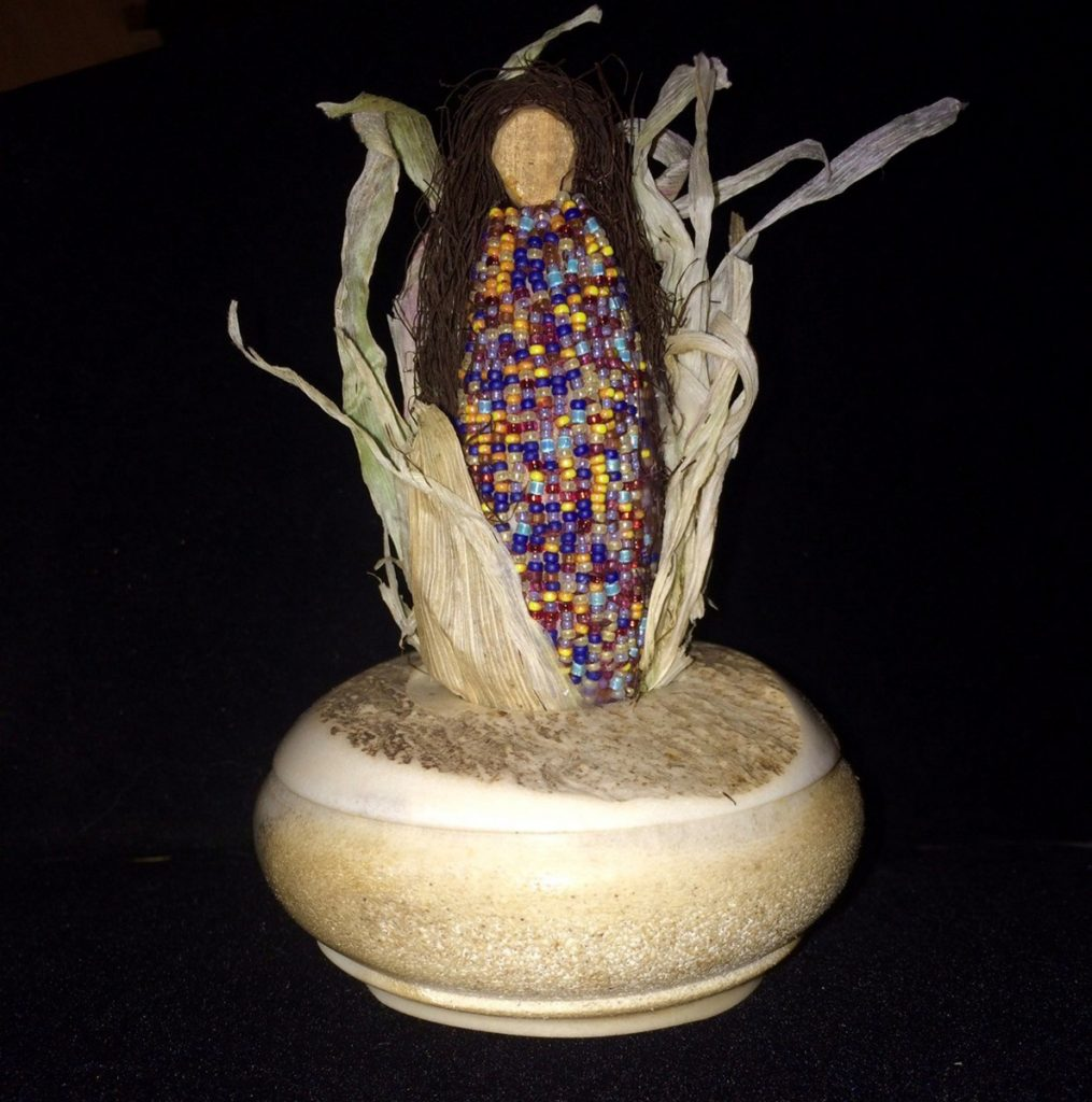 """Corn Mother,"" by Kathy Pollard, glass beads, corn husks and a moose antler."