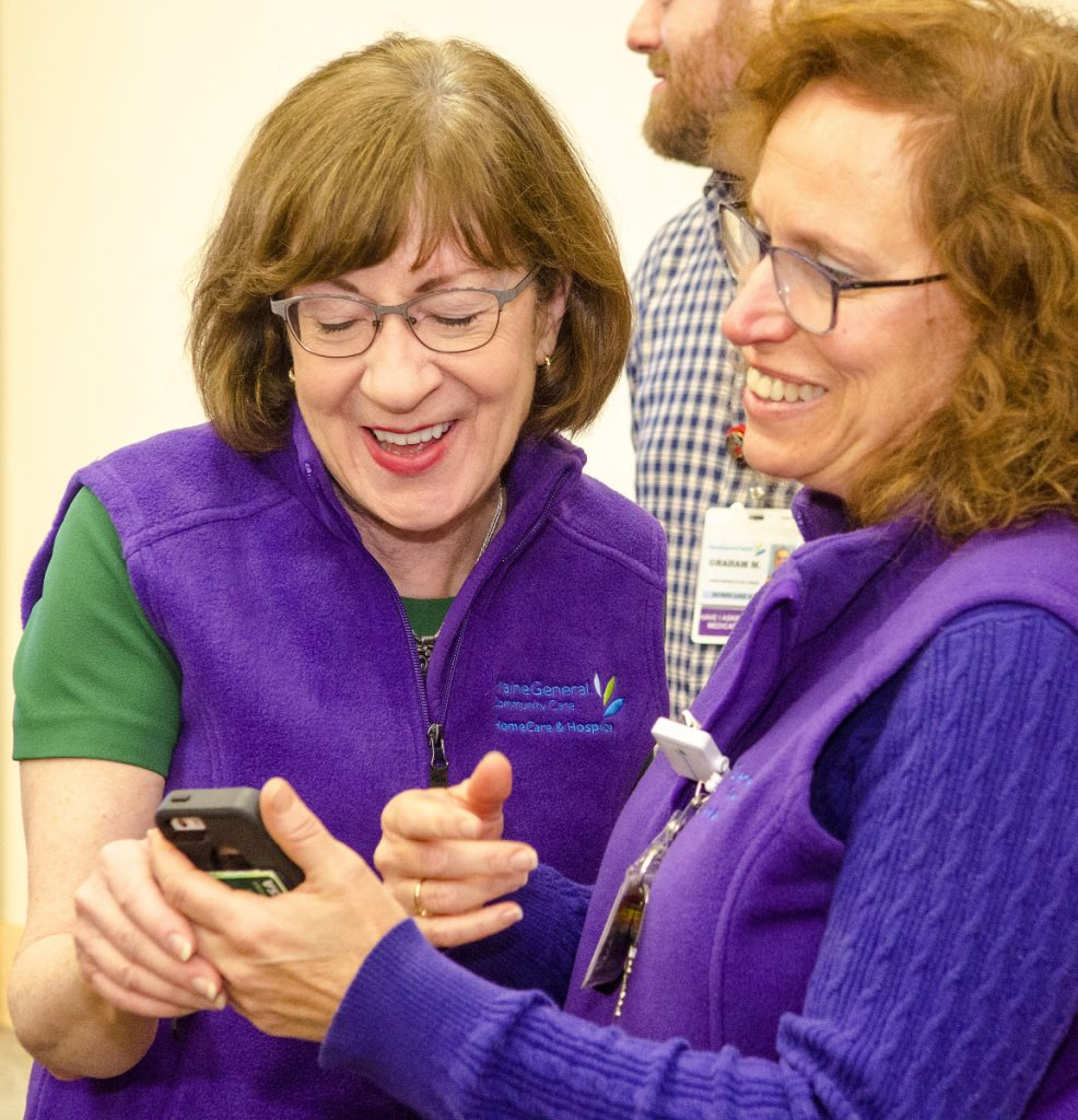 U.S. Sen. Susan Collins, R-Maine, left, chats with Gina Mosca on Wednesday after speaking to home care and hospice workers at MaineGeneral Medical Center's Alfond Center for Health in Augusta.