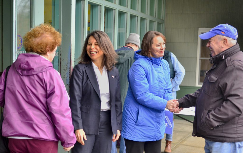 Kennebec and Somerset County District Attorney Maeghan Maloney, second from left, and Sen. Shenna Bellows, D-Manchester, greet voters around 8:50 am. Tuesday at the Boys and Girls Clubs of Kennebec Valley in Gardiner.
