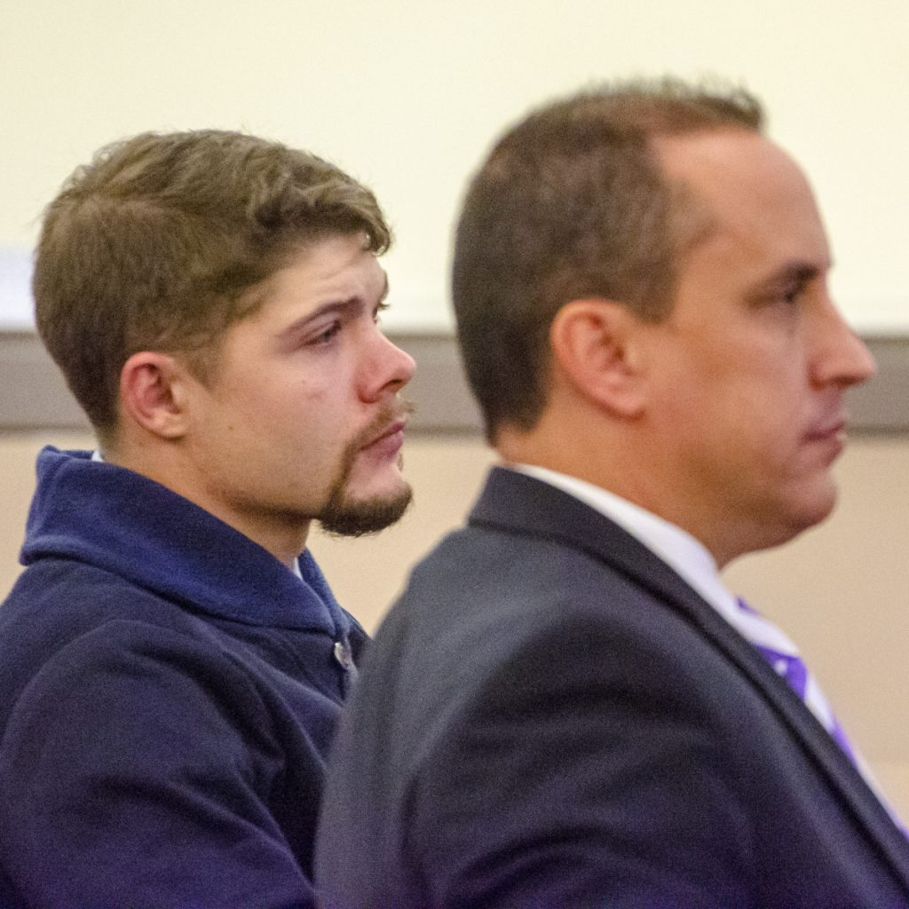 Tyler Goucher, left, and his defense attorney Darrick Banda sit in court Wednesday during a plea hearing at the Capital Judicial Center in Augusta.