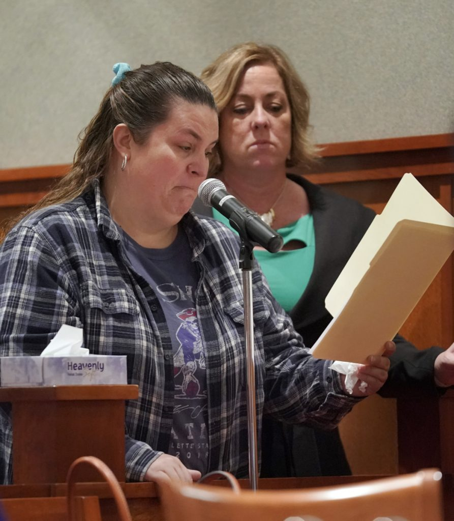 Victoria Beloin, standing with Michelle Cran, a victim-witness advocate, reads a statement Friday during David Marble's sentencing hearing at the Cumberland County Courthouse in Portland. Marble, who was found guilty of murdering Eric Williams and Bonnie Royer, was sentenced to life in prison without the possibility of parole. Beloin is the partner of Royer's father.