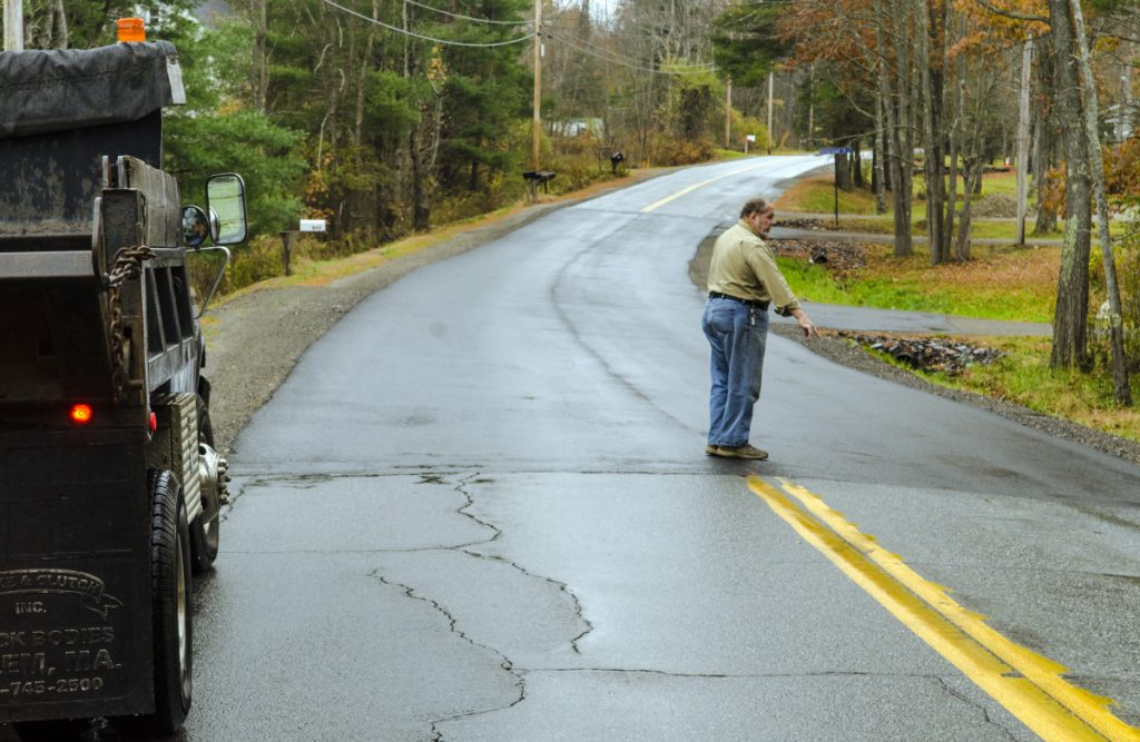 Farmingdale Road Commissioner Steve Stratton talks about the pavement level on a recently repaired section of Northern Avenue on Thursday in Farmingdale.