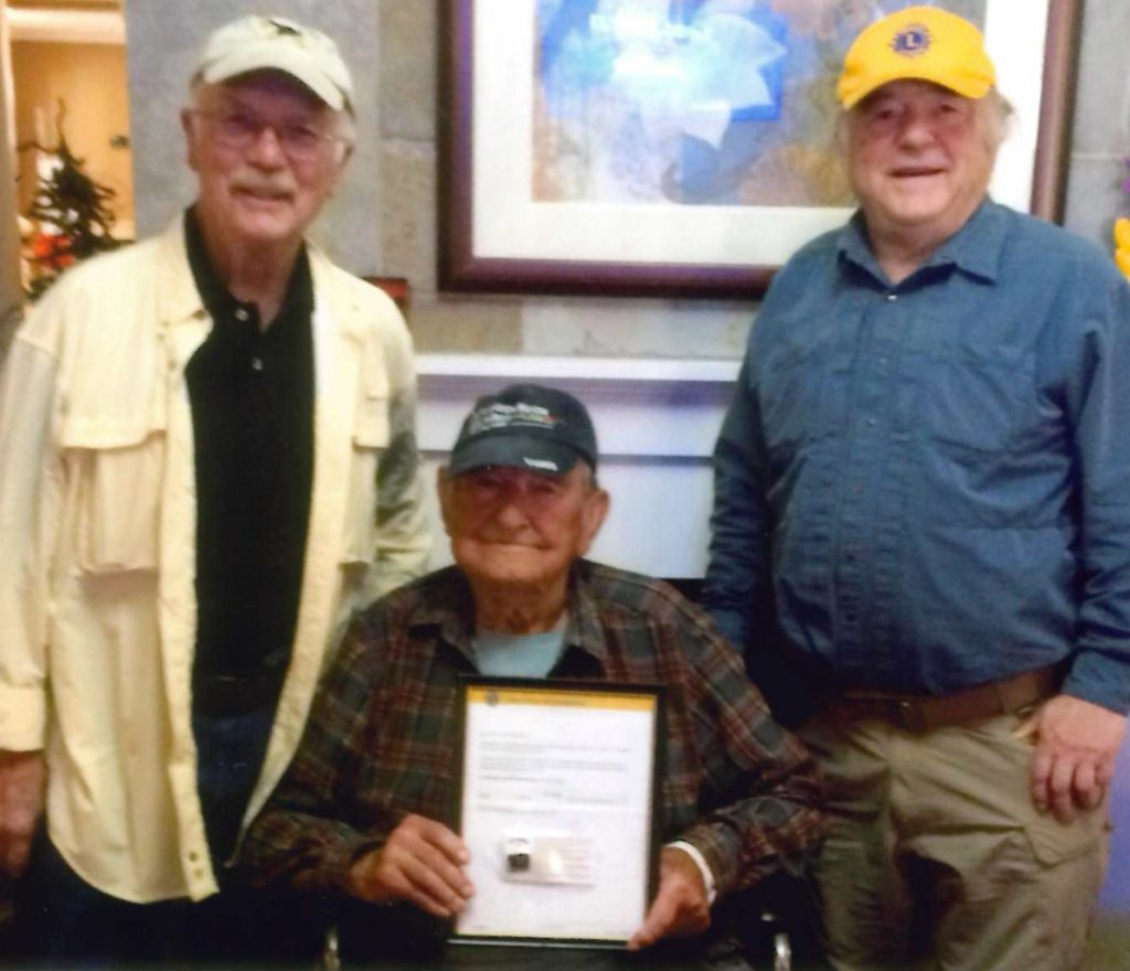 Monmouth Lions Club members from left are Aaron Paradis, his grandfather James Paradis and Guy Piper. James Paradis was presented the Lions Club International Silver Centennial Membership Award on Oct. 10.