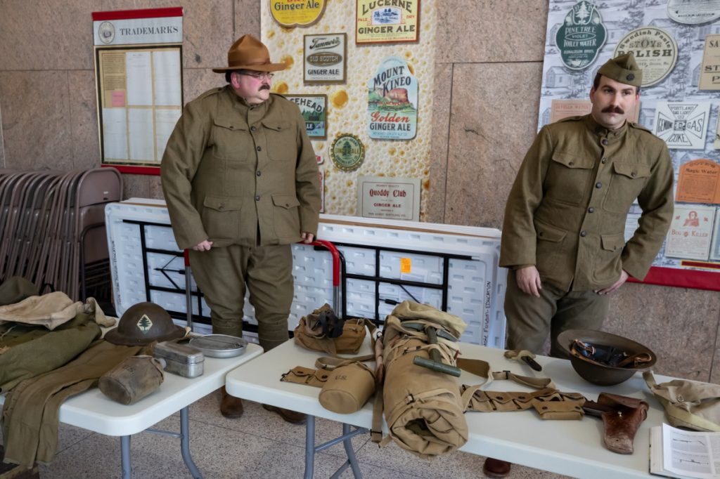 Dave Backus, of Waldoboro, left, and his son, Tom Backus, of Warren, right, stand in period uniform to display items that American Soldiers carried during World War One in Augusta on Sunday. Armistice Day Centennial Celebration, starting at the 11th hour on the 11th day of the 11th month of the year was to mark the 100th year anniversary of the armistice signed between Germany and the Allies which officially ended The Great War.