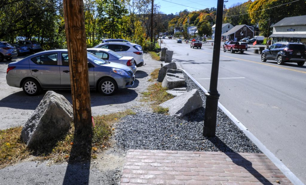 The new sidewalk ends at the Lucky Garden restaurant parking lot, as seen on Oct. 22 on Water Street in downtown Hallowell.