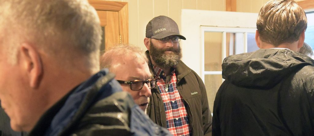 James Marcoux, center, attends the groundbreaking Tuesday for the Bread of Life Shelter expansion in Augusta. The Marine Corps veteran stayed at the shelter while rebuilding his life and currently helps collect food for the entity.