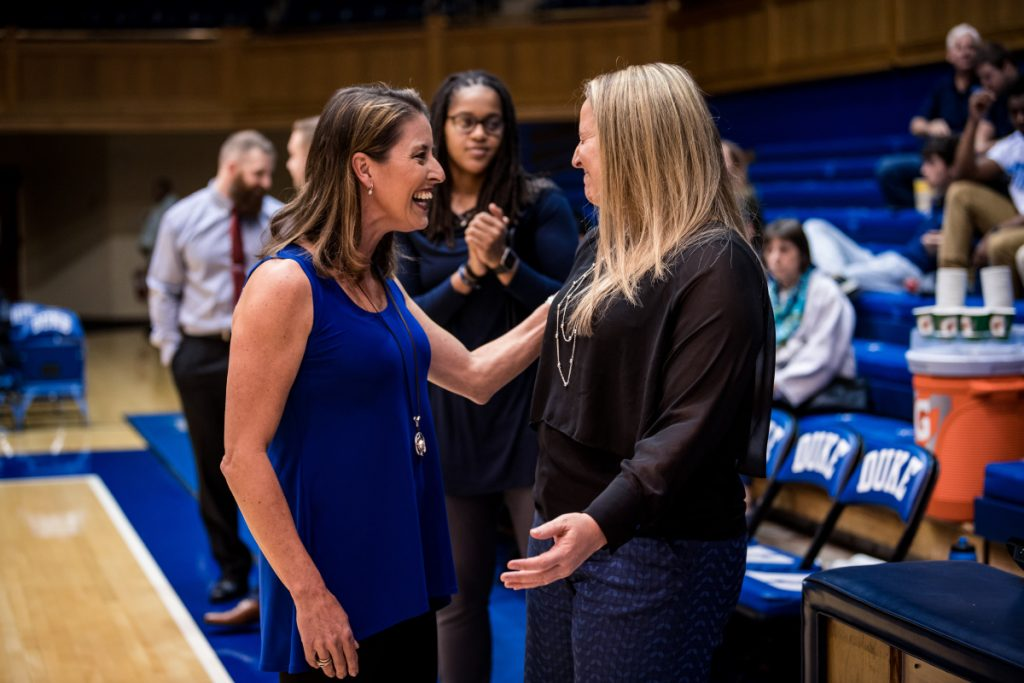 Duke women's basketball coach Joanne McCallie talks with Maine coach Amy Vachon prior to a game last season in Durham, North Carolina.